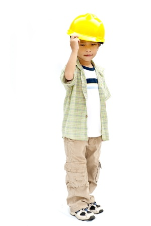 child with a yellow helmet isolated on white background Stock Photo