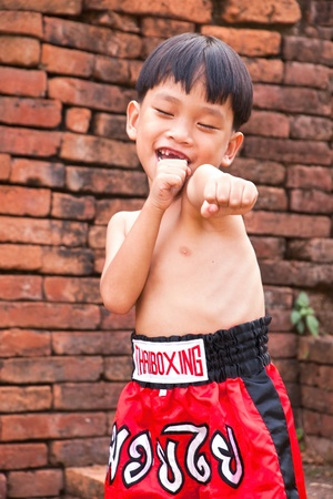 Thai people in the history use Muay Thai for fought and protection thai boxing letters on the pants and belt without banner but use calling name sport  muay thai  photo