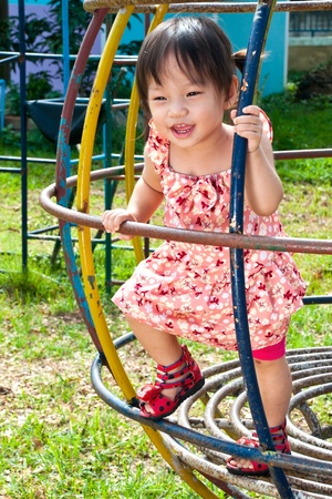 Asian Little girl playing in Playground of Thailand Stock Photo - 13546934