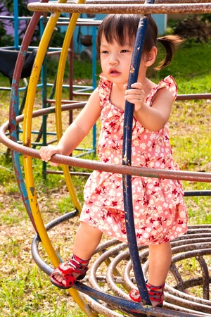 Asian Little girl playing in Playground of Thailand Stock Photo - 13546936