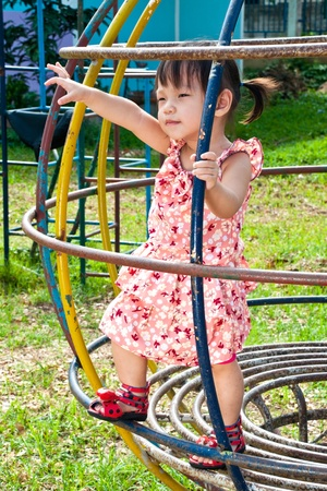 Asian Little girl playing in Playground of Thailand Stock Photo - 13546939