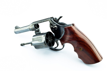 old revolver with bullets on white background photo