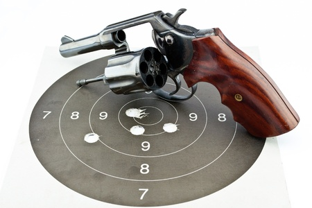 old revolver with bullets on white background