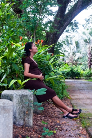 beautiful pregnant mother to be in nature
