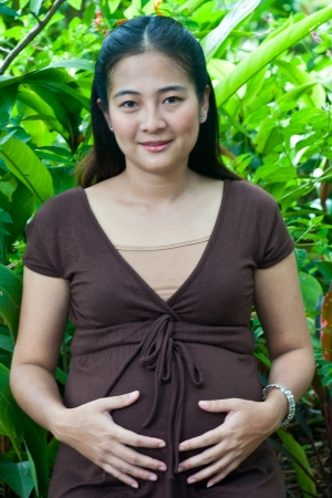 untitled key: beautiful pregnant mother to be in nature