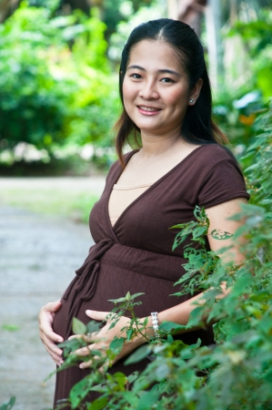 obgyn: beautiful pregnant mother to be in nature