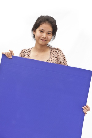 Pretty Asian young girl behind a Purple board on white background photo