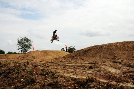 NAN, THAILAND - JUN 02: An unidentified rider participates in the 3rd round (test drive) of Motocross 2012 Thailand motocross Junior championship on June 02, 2012 in Nan Province, Thailand.