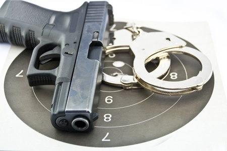 9-mm handgun automatic and police handcuff on white background Stock Photo - 15423834