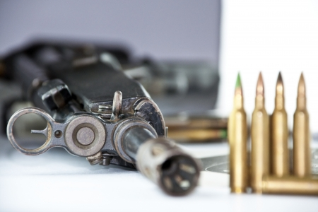 Close up of rifle and bullets on white background