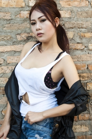 Beautiful young Asian woman wearing blue short jean photo