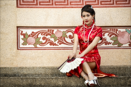 cheongsam: Chinese girl in traditional Chinese cheongsam blessing