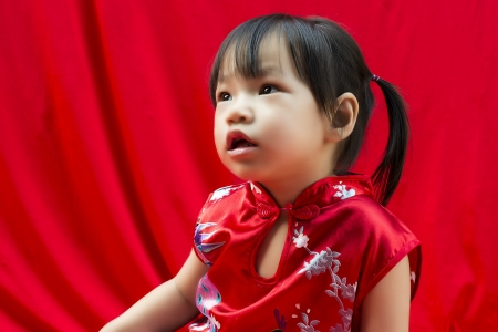 China girl in traditional chinese red tang suit greeting stock photo china girl in traditional chinese red tang suit greeting stock photo 17846843 m4hsunfo