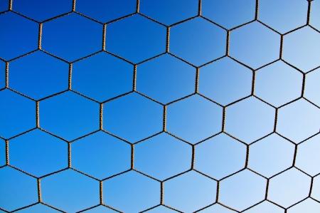 soccer net: Soccer net with on blue sky background Stock Photo