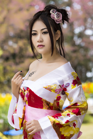 Asian woman wearing traditional japanese kimono photo