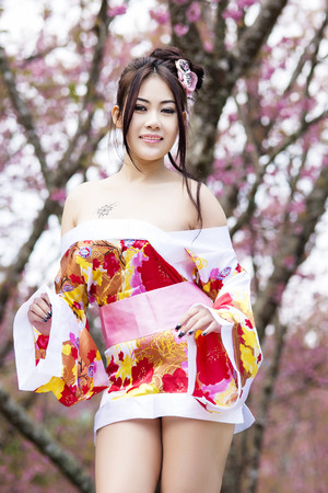 Asian woman wearing traditional japanese kimono photo