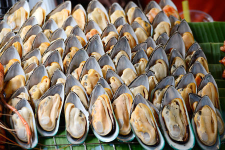 ostracean: many fresh oyster on fire , food in Thailand