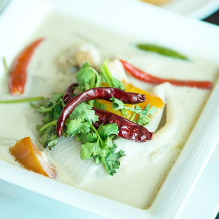 thai cuisine- tom kha kai -chicken in coconut milk soup photo