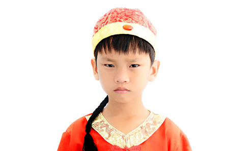 China boy in traditional Chinese red Tang suit greeting photo