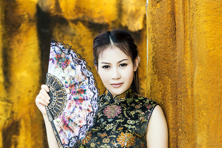 Chinese woman in traditional cheongsam dress photo
