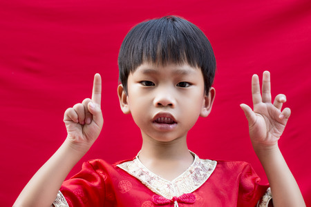 China boy in traditional chinese red tang suit greeting stock photo china boy in traditional chinese red tang suit greeting stock photo 36090882 m4hsunfo