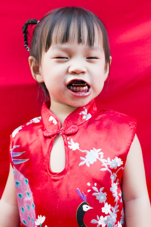 China girl in traditional chinese red tang suit greeting stock photo china girl in traditional chinese red tang suit greeting stock photo 36090884 m4hsunfo