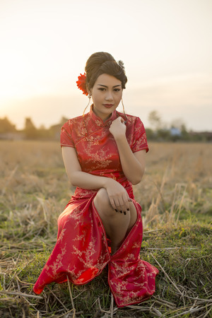 Chinese woman red dress traditional cheongsam ,close up portrait