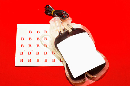 group b: Close up bag of blood and plasma group B isolated on Red background