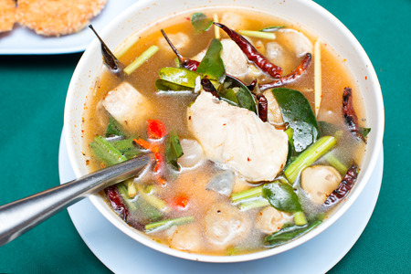 snakehead: tom yum soup ,Thai style Spicy soup with fish- Local Thai food : Tom Yum spicy lemongrass soup with striped snakehead fish