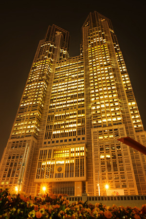 high rises: TOKYO, JAPAN - APRIL 17, 2014: The Tokyo Metropolitan Government building. The building is headquarters of the Tokyo Metropolitan Government which governs 23 wards and outlying cities.
