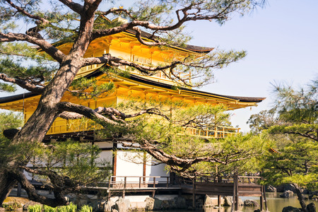 whose: Kinkakuji Golden Pavilion is a Zen temple in northern Kyoto whose top two floors are completely covered in gold leaf. Stock Photo