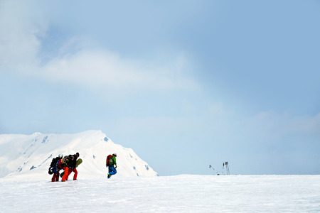 snow covered mountain: Skiers walking on snow covered mountain ranges, Tateyama, Japan