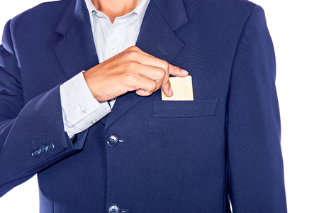 out of body: Part of body of business man who takes out business card from the pocket of business sui