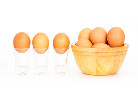 lecithin: Fresh eggs in a bowl on white background