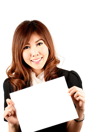 smile please: young attractive asian woman holding blank white board
