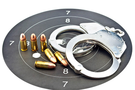 luger: 9mm Luger Ammunition and Handcuffs on target