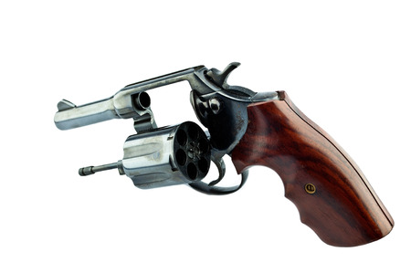 firearms: black revolver handgun with bullets isolated on isolate background. (gun target firearms shoot sights violence)