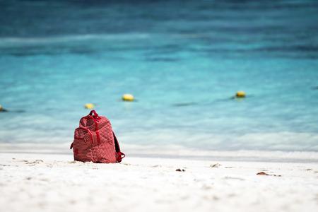 red bag on the beach ,Asians beautiful the beach and white sand beach at Koh Ta Chai Andaman Sea