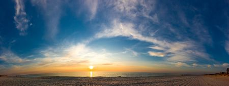 Panorama of sunset seacoast. Sand and waves photo