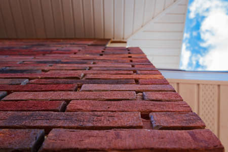 Clinker brick of brown color. Clinker thermal panels for finishing the facade of the house. Tiles for outdoor decoration