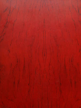 The background of the board is mahogany with a beautiful texture. Section close-up.