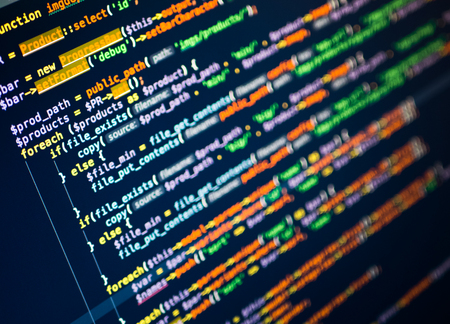 Lines of php code on the monitor. Dark blue background. Macro Stock Photo - 98798800