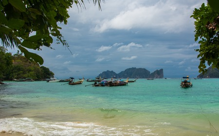 Beach with long tale taxi boats on island, Phi-Phi. Panoramic view