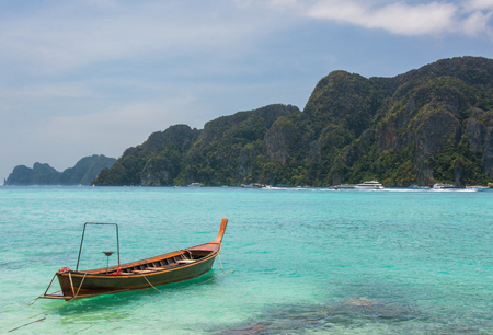 Long tail taxi boat on Andaman island. Turquoise water and mountain view. Relax and paradise concept