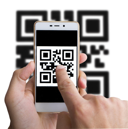 Scanning barcode using smartphone, close up. Two man hands holding phone and pointing on the qr code on the screen. Isolated on white.