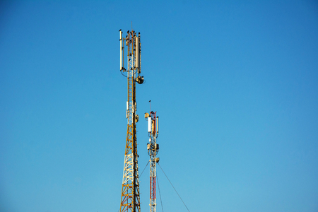 Telephone antenna on clear blue sky background. Sunny day. 4G and 4.5G Cell site, Telecom radio tower or mobile phone base station