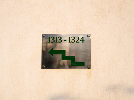 Green stepped arrow to the left with numbers 1313-1324