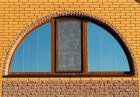 Half-round window in brick wall, house exterior, closeup Archivio Fotografico - 113706050