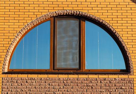 Brick wall with semicircle window, close up Archivio Fotografico - 115774903