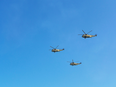 Airshow. Three flying in the blue sky